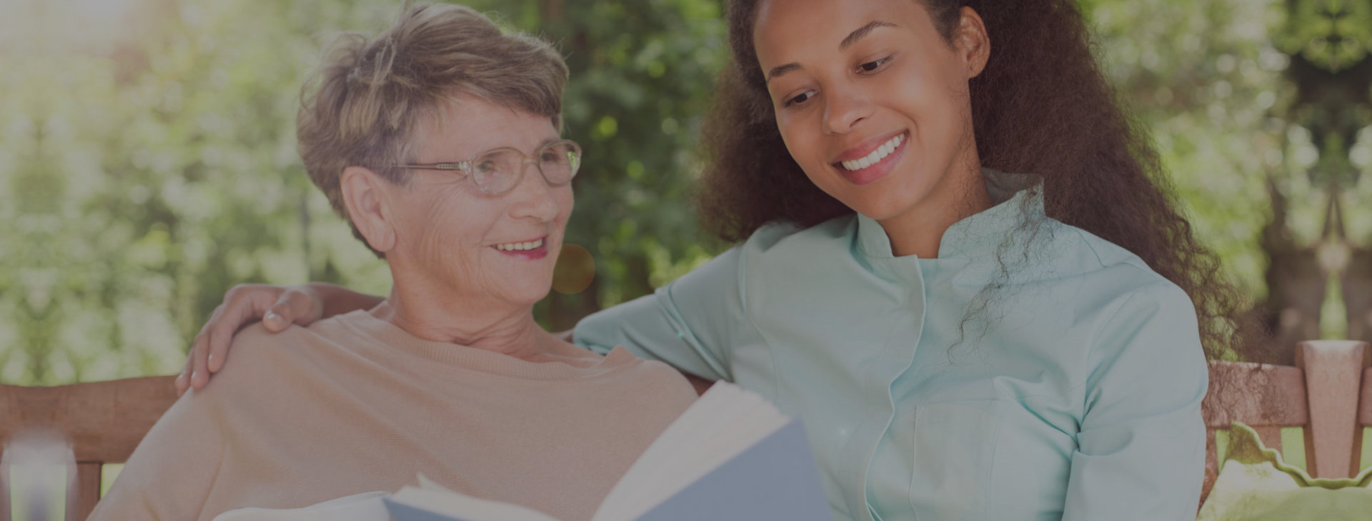 caregiver reading books with her patient